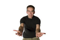 Young Man with Reaching Arms. A young man with his arms stretched out and an impatient look on his face, isolated against a white background Royalty Free Stock Photos