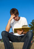 Young Man read a Book Stock Images