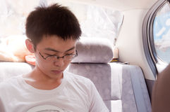 Young man read in car Stock Image