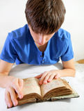 Young Man read the Old Book Stock Image