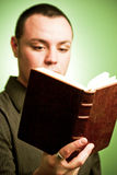 Young man reading. Hardcover book Royalty Free Stock Photography