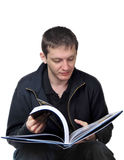 Young man reading Royalty Free Stock Photos