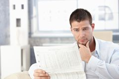 Young man reading bad news Royalty Free Stock Photography