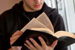 Man Reading Bible. Young man reading the Bible stock photos