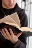 Man Reading Bible. Young man reading the Bible stock images