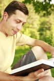 Young man reading the Bible Stock Images