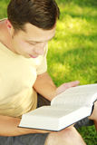 Young man reading the Bible Stock Photos
