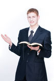 Young man reading Bible Stock Image