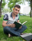 Young man reading Bible Royalty Free Stock Photo