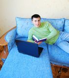 Young man reading a book. Royalty Free Stock Photography