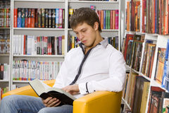 Young Man Reading Book Royalty Free Stock Photography