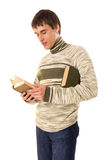 Young man reading the book. Young man standing and reading the book. isolated on white Stock Photo