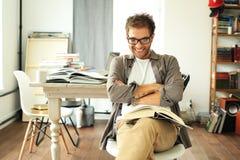 Young man reading book Royalty Free Stock Photos