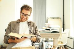 Young man reading book Stock Photo
