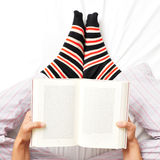 Young man reading a book in bed Royalty Free Stock Photo