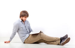 Young man reading a book Stock Photos