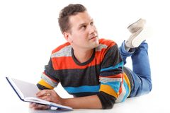 Young man reading a book on the floor isolated Royalty Free Stock Images