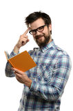 Young Man Reading Book and Gesturing Royalty Free Stock Images