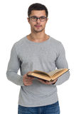 Young man reading a book. Handsome young man reading a book, isolated on white Royalty Free Stock Photos