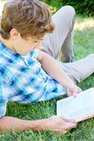 Young man is  reading a book Stock Photography