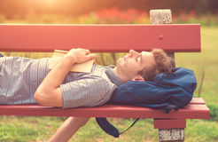 Young man reading a book in park Stock Photo