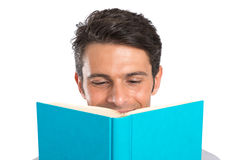 Young Man Reading Book Royalty Free Stock Images