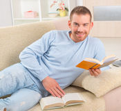 Young man reading book Royalty Free Stock Photo