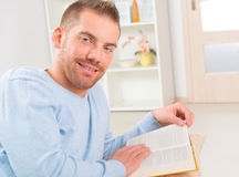 Young man reading book Stock Images