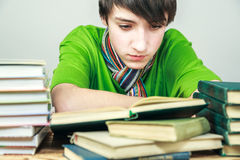 Young man reading a book. The student Royalty Free Stock Photo