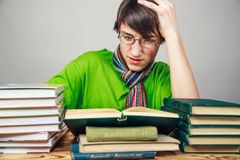Young man reading a book. The student Stock Images
