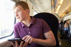 Young Man Reading A Book On Train Journey Stock Photos