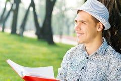 Young man reading a book Stock Photos