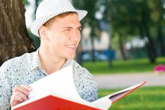 Young man reading a book Royalty Free Stock Photography