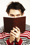 Young man reading  book on white background. Closeup Royalty Free Stock Image