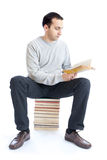 Young man reading a book on white background Royalty Free Stock Photo