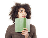 Young man reading book on white background Royalty Free Stock Photo