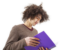 Young man reading book on white background Royalty Free Stock Images