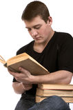 Young man reading a book. On a white background Royalty Free Stock Images