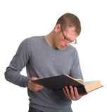 A young man reading a great book Stock Image