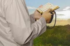 Young Man Reading The Holy Koran Stock Images