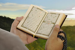 Young Man Reading The Holy Koran Royalty Free Stock Images