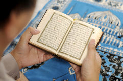 Young Man Reading The Holy Koran. At the mosque Royalty Free Stock Image