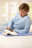 Young man reading at home Royalty Free Stock Photo