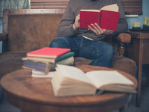 Young man reading at home Stock Images