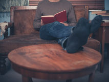 Young man reading at home Royalty Free Stock Image