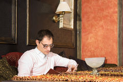 Young Man Reading In Luxury Interior