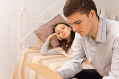 Young man reading a letter in the bedroom Stock Photography