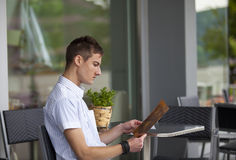 Young man reading the menu Stock Photo