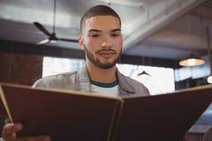 Man reading menu Stock Photography