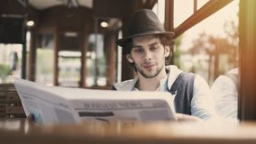 Young man reading newspaper in the bus stock photo